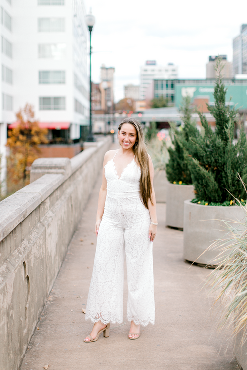 Bride-to-be wearing white lace jumpsuit | Bridal shower, bachelorette party, engagement dress | The Blakely | Eternal Ivory