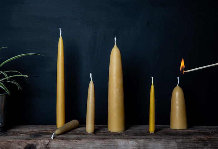 slender tapered natural beeswax candles