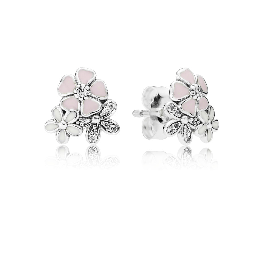 A silver stud with flowers on it by pandora