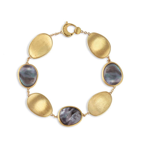 A gold and mother of pearl Marco Bicego Bracelet part of the Lunaria collection Santa Fe Jewelry.