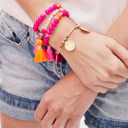 hot pink stacking bracelet with neon tassel — Ordinary Luminary