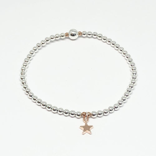 Rose gold mini star charm bracelet on stretch elastic with silver plate beads