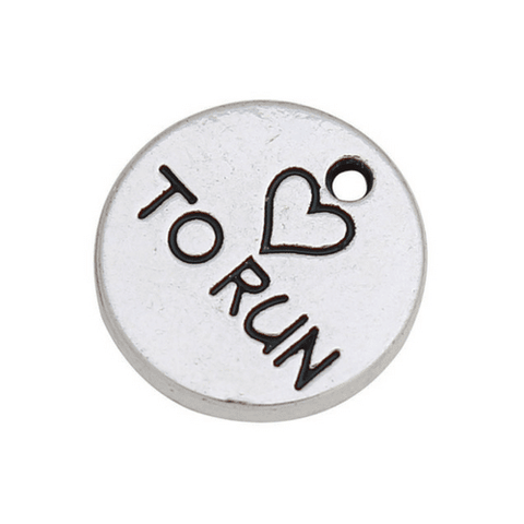 <strong>MÉDAILLE CHARM ''TO RUN'' EN METAL ARGENTÉ</strong>