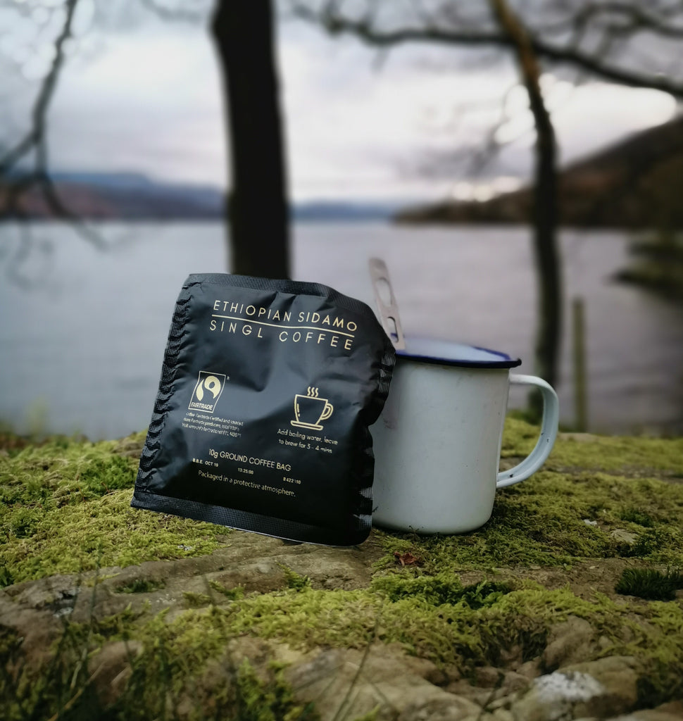 Ethiopian Sidamo Coffee bag by the side of a lake