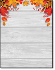 fall leaves over table stationery letterhead paper sheets