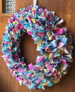Spring colored scrap fabric wreath in pink, teal, purple, and yellow