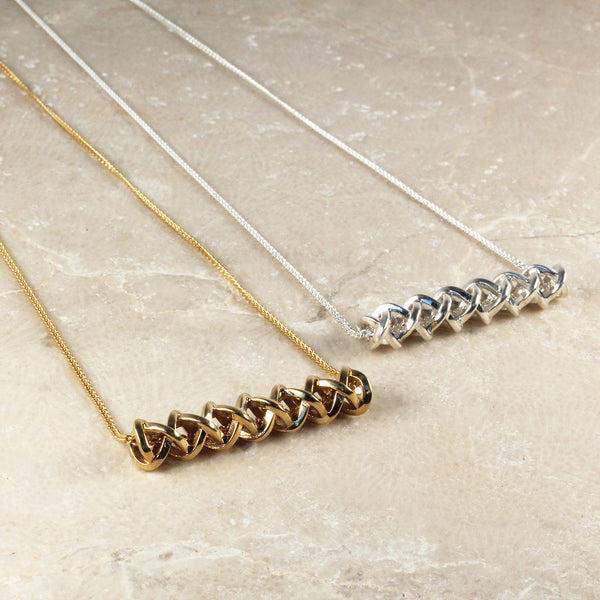 Into The Wild necklaces in brass and silver