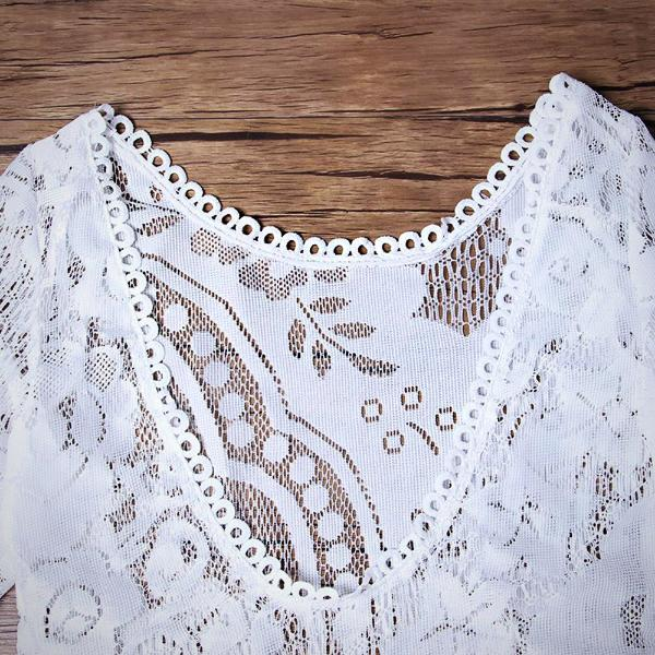 Ideal packing for your holiday, this white Side Split Lace Beach Dress pairs perfectly with both swimsuits and bikini sets.