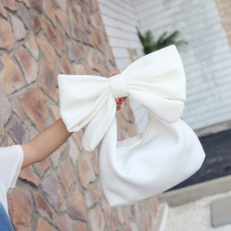 Designed in a unique and cute style, this Elegant Big Bow Handbag is the perfect bag for your summer special occasions.