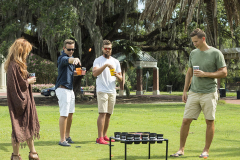 """Group of people playing Corkaine lawn game at City Park in New Orleans"""