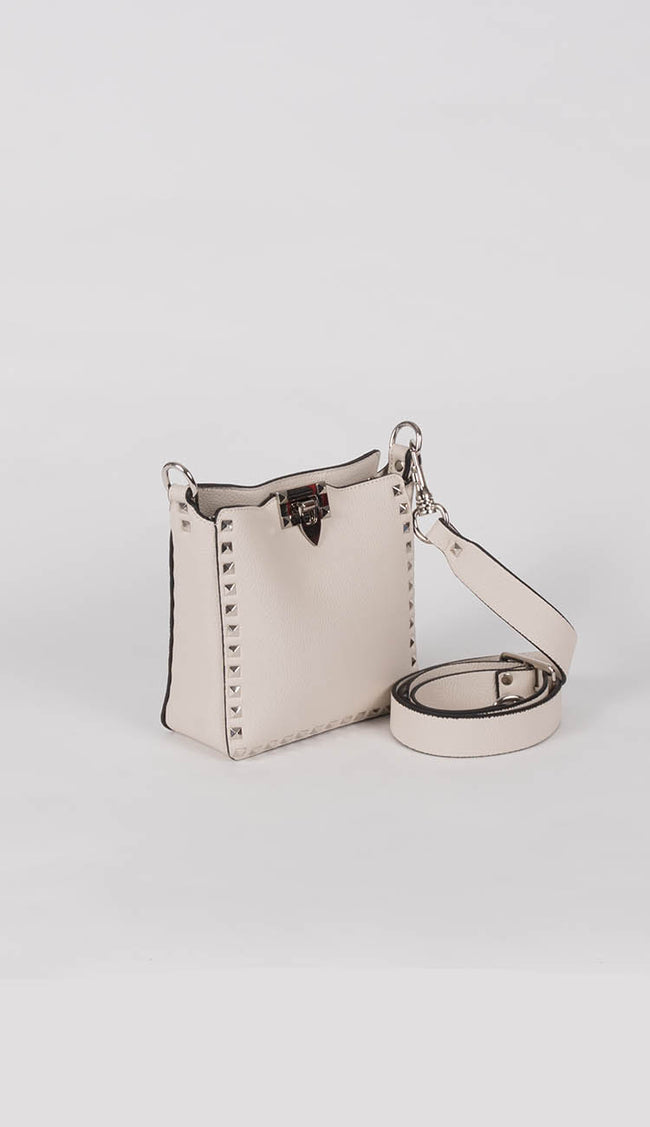 beige studded mini crossbody by inzi