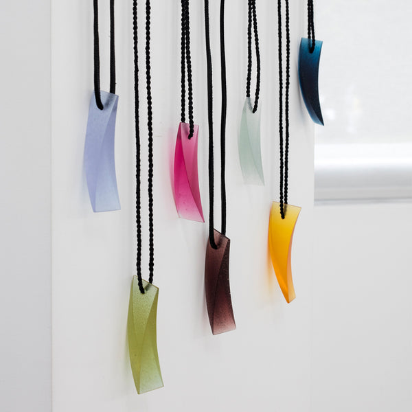 Galia Amsel Cast Glass Neckpieces Hanging on Wall